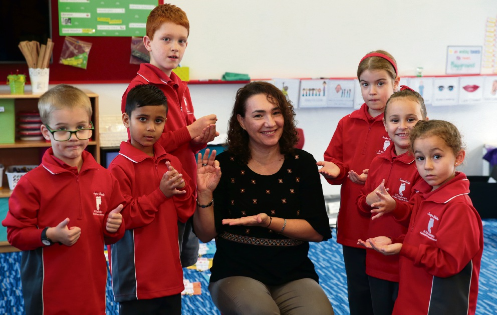 Teacher Marie Ware with Jake, Ashton, Nathaniel, Lillian, Sienna and Carma. Picture: Martin Kennealey