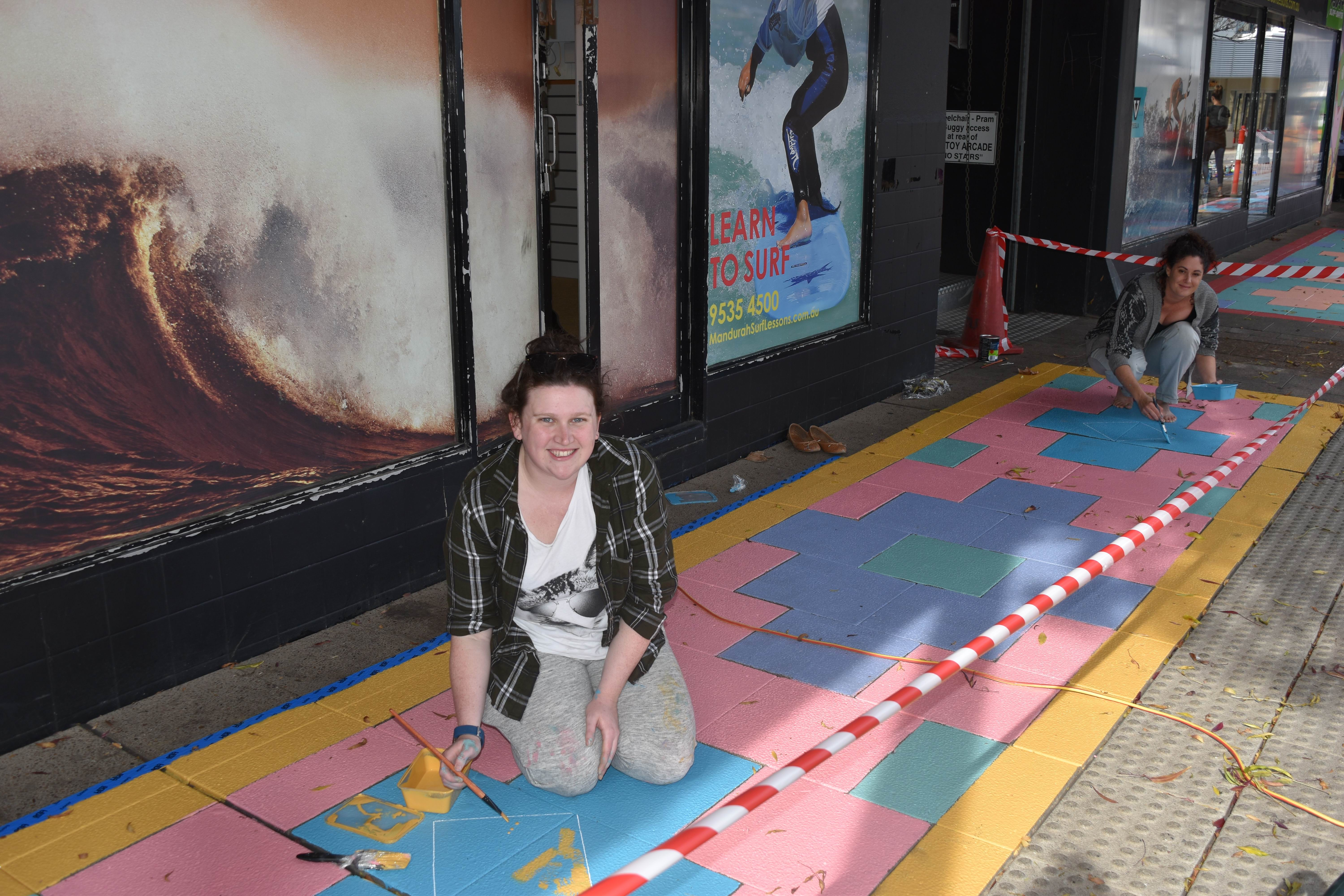 Street artists Emma Jackson and Tahnee Kelland paint the Moroccan rug inspired path