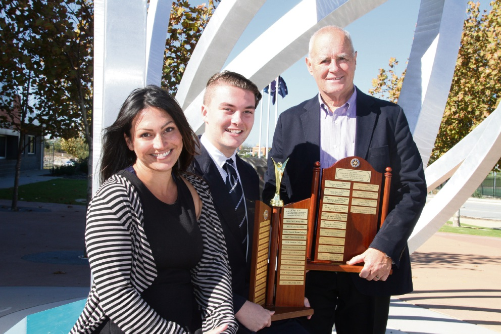 Butler College teacher Sarah Johnson, student Harry Harrop and Mindarie Rotary Club's Brian Butterworth.