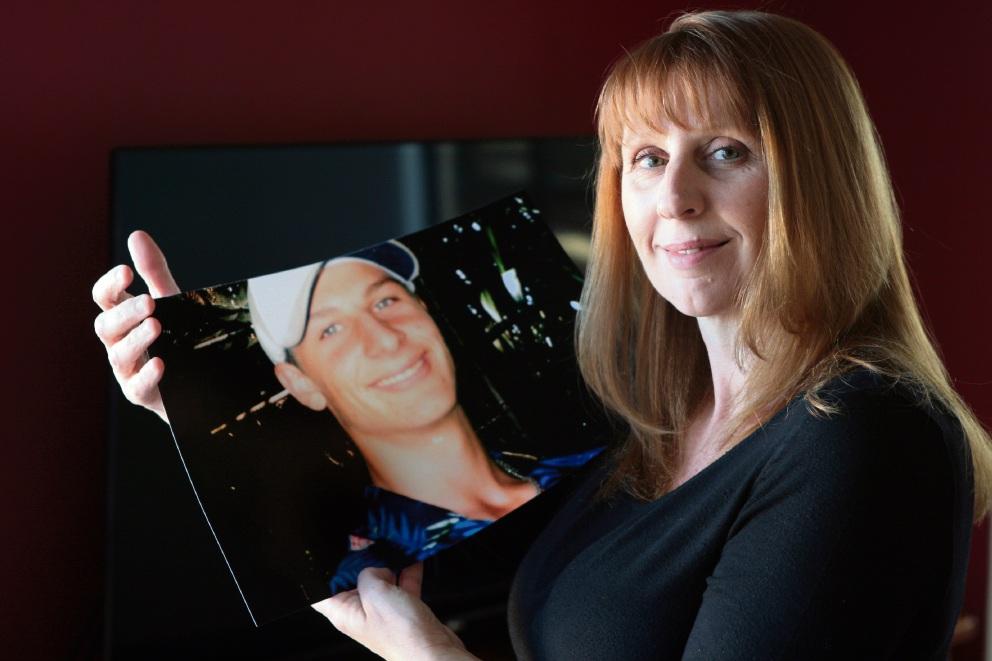 Collette Wright with a photograph of her son Nathan, who took his own life in 2009. Picture: Bruce Hunt