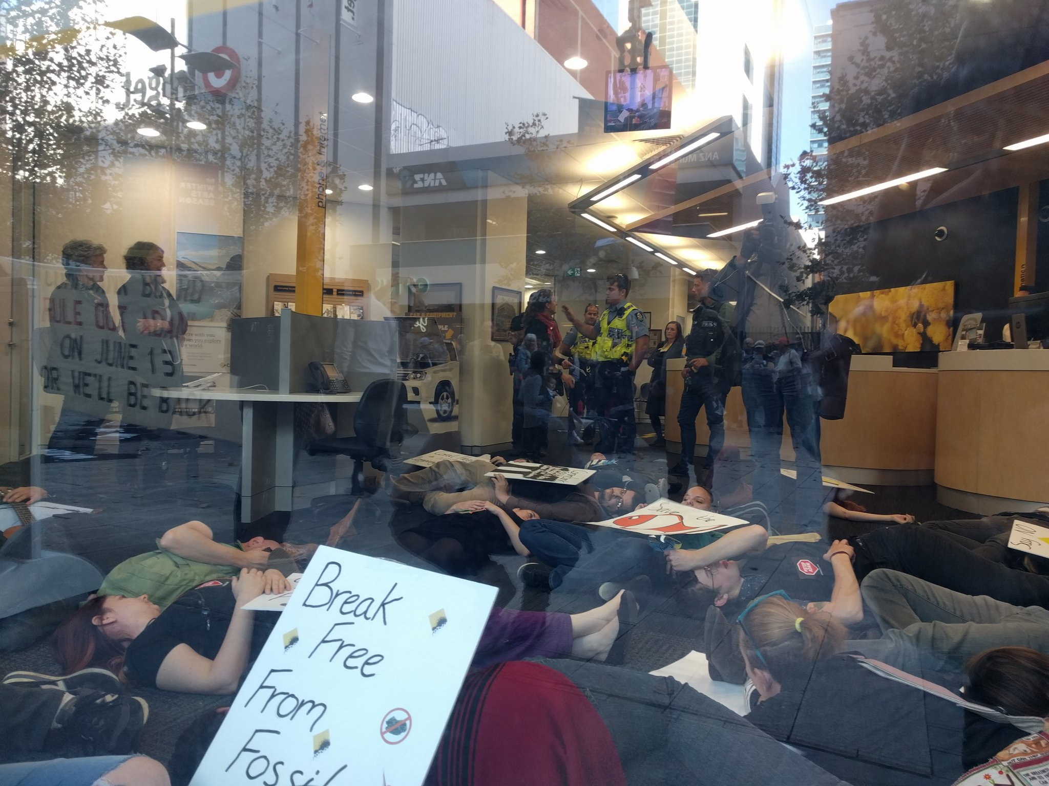 A lie-in inside the Commonwealth Bank in Murray Street today. Photo: Twitter/@troutish