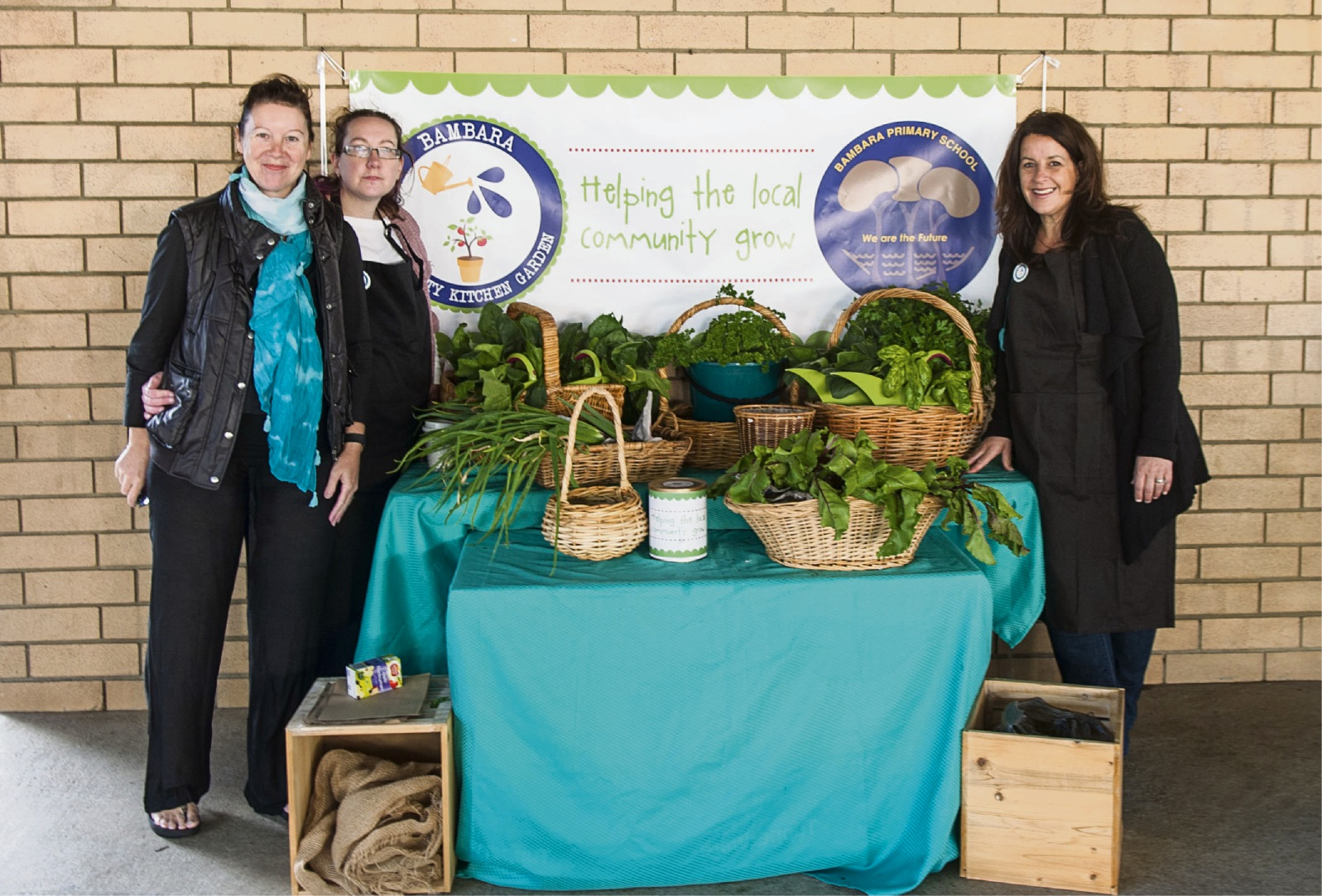 Shelley Webb, Jodie Moss, Morena Howe with the kitchen garden.
