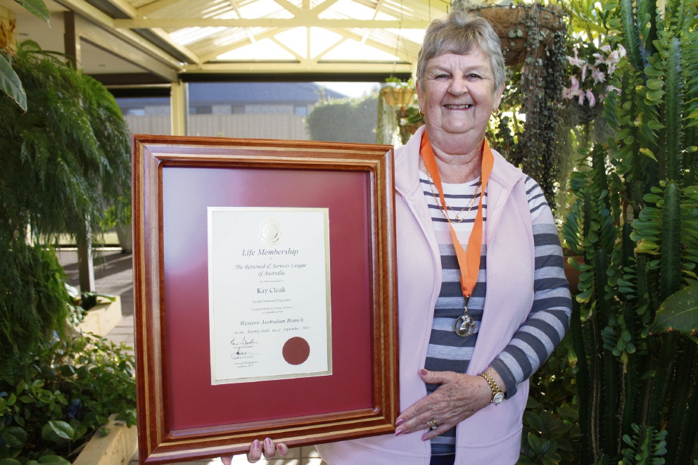 Kay Cleak with her RSL life membership award.