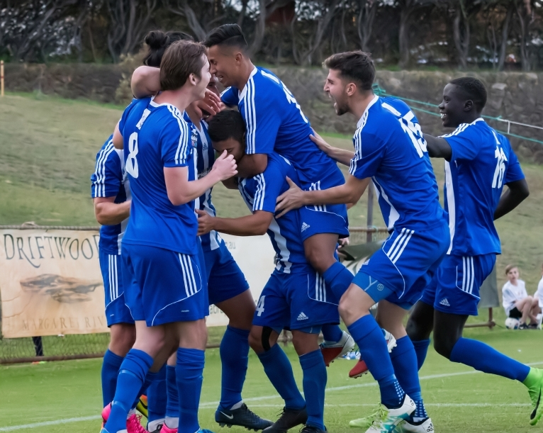 Floreat Athena players celebrate a goal against Perth SC. Picture: Foto Enzo