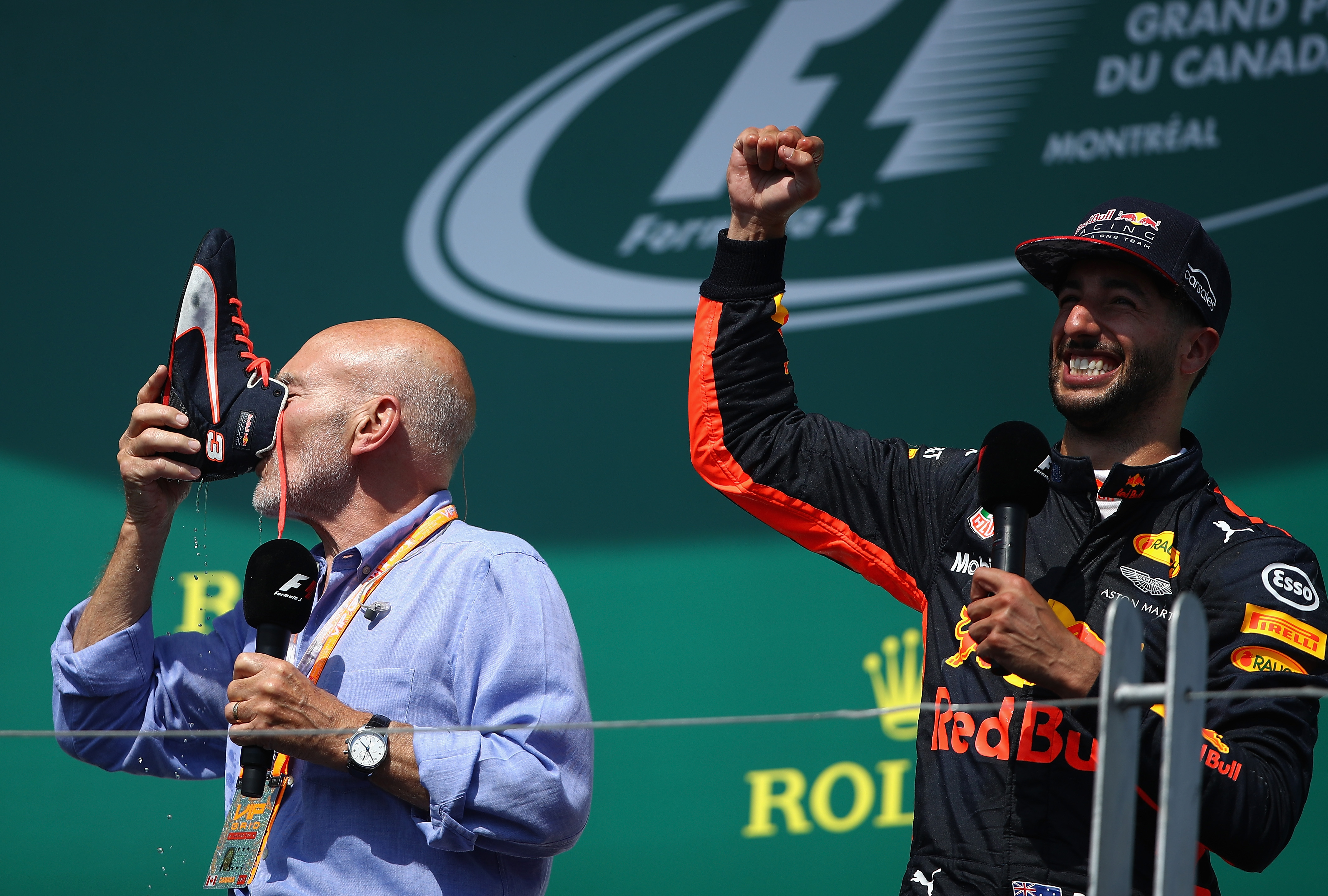 Actor Sir Patrick Stewart celebrates on the podium with Daniel Ricciardo and a shoey after Ricciardo's podium finish at the Canadian Formula One Grand Prix. Picture: Clive Mason/Getty Images
