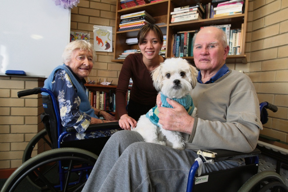Woody the Maltese Shitzu, with residents Margaret Trus and Charles Scott, has been to Villa Maria with owner Tracy Sam San Tive (centre) before.    d469695