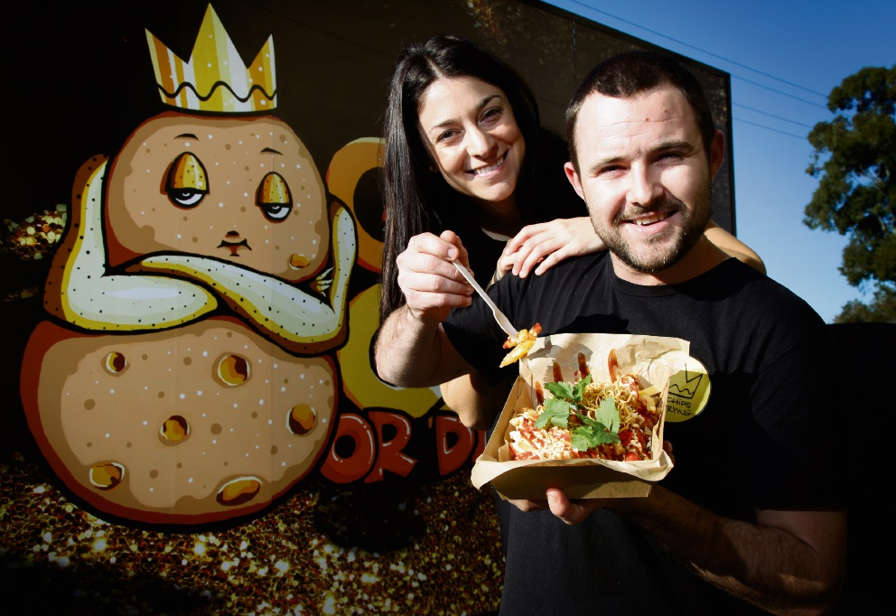 Partners Larah Di Nella and Sam Elliott run food truck Get Chips or Die Frying. Picture: Marie Nirme �������www.communitypix.com.au   d469956
