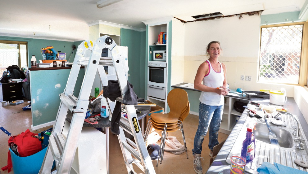 Kat Wiseman helped repaint the refuge houses. Picture: Martin Kennealey d469616