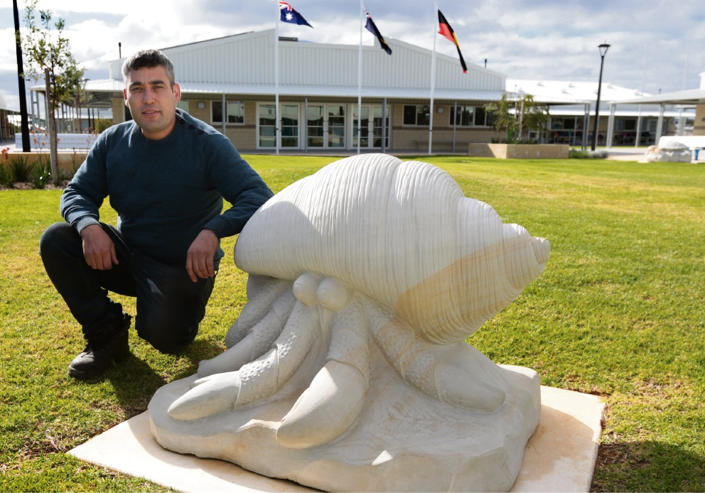 Students give sculptor Mehdi Rasulle their seal of approval. Picture: Martin Kennealey  d469512