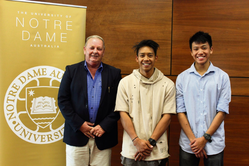 Kelvin Matthews with the Shire of Christmas Island Scholarship recipients Haziq Mohd Jahis and Jasman Lew.