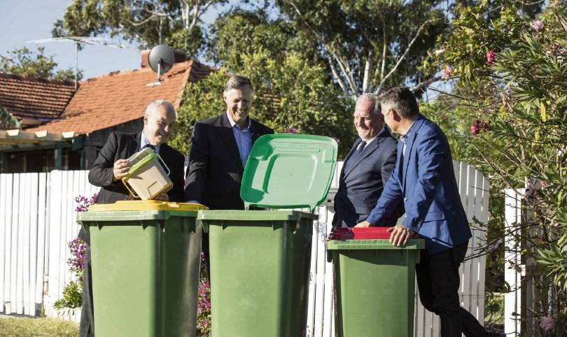 Melville Mayor Russell Aubrey, South Metropolitan Regional Council chairman Cameron Schuster, East Fremantle Mayor Jim O'Neill and Fremantle Mayor Brad Pettitt check out the new bins.