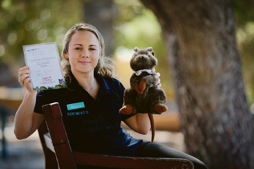Alanna Cooper with a quokka and adoption certificate Picture: Andrew Ritchie
