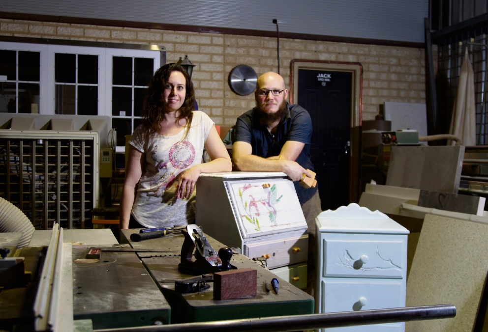 Nicole and Bryce Polmear in their workshop with some of their restored pieces of furniture.  Picture: Marie Nirme d470113