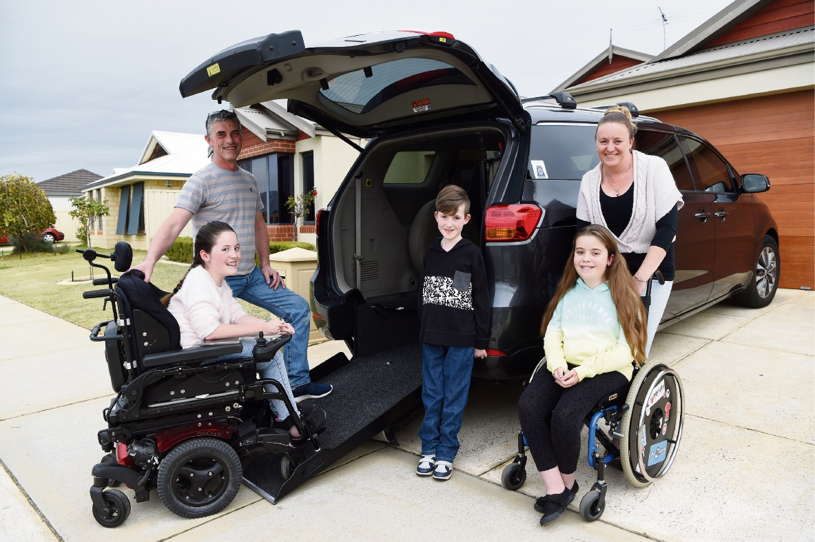 Colin and Narelle Topham with their children Jaimie, Scott and Hayley – all of whom have muscular dystrophy – are so grateful to the people who made possible an $85,000 modification to their car. Picture: Jon Hewson �������www.communitypix.com.au   d470268