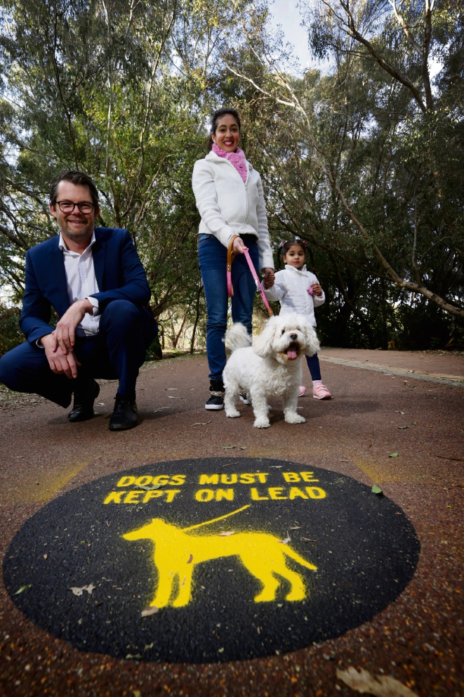 Cr Dan Bull with resident Tanya Krishnan and daughter Gianna (2) and Mischa the dog. Residents are concerned about dogs running off lead from Riverside Gardens into the protected Eric Singleton Bird Sanctuary Picture: Andrew Ritchie d470415