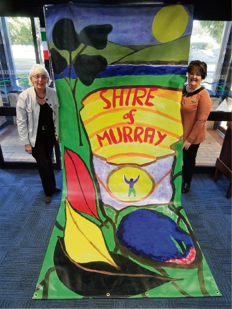 Brenda Beacham and Maree Read with the banner.