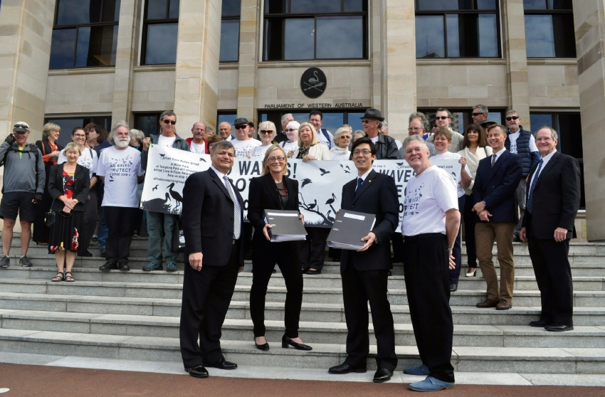 Alfred Cove Action Group spokesman Clive Ross and Tom Lubin flank Bicton MLA Lisa O'Malley and South Metropolitan MLC Pierre Yang on the steps of Parliament House last week.