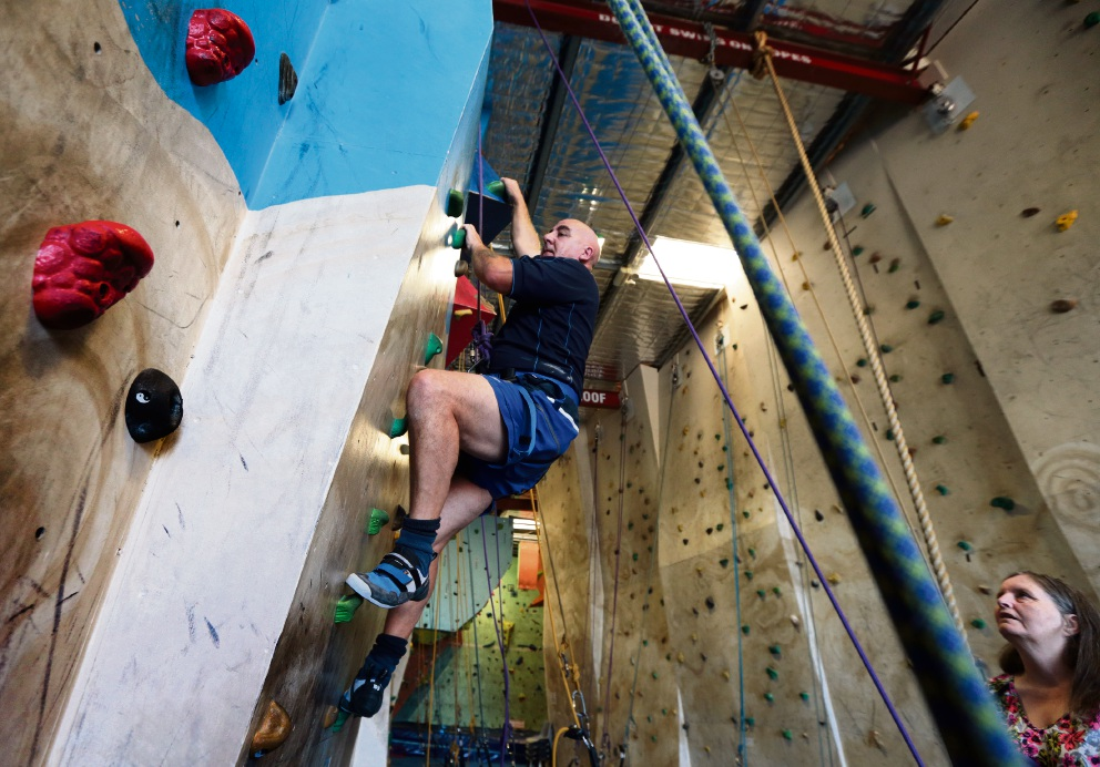 Alex Duff tries his hand at indoor rock climbing. Picture: Martin Kennealey   d470302