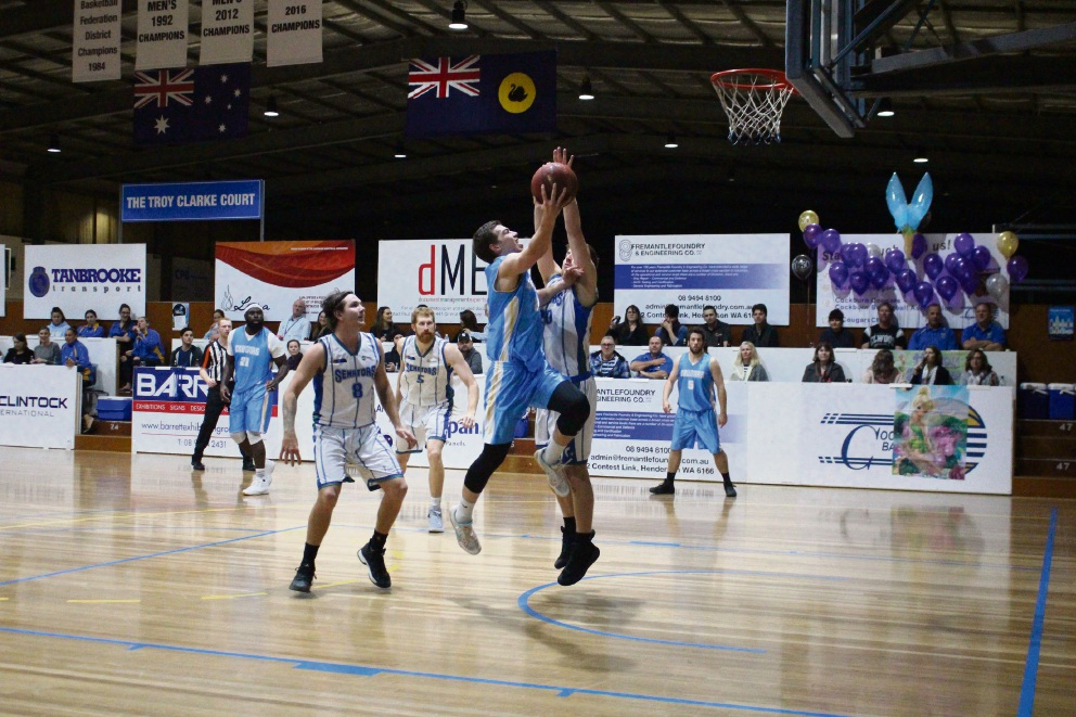 Cockburn's Lochlan Cummings takes it to the ring against Stirling on his way to 21 points for the game.