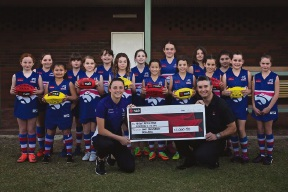Ashley Sharp presents the cheque from NAB |regional manager Joe Farone, with the High Wycombe Junior Football Club junior girls looking on.