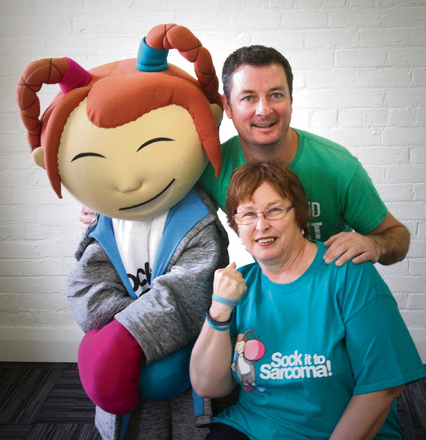 Sock it to Sarcoma co-ordinator Mandy Basson with Just Improvise's Glenn Hall and the campaign mascot.