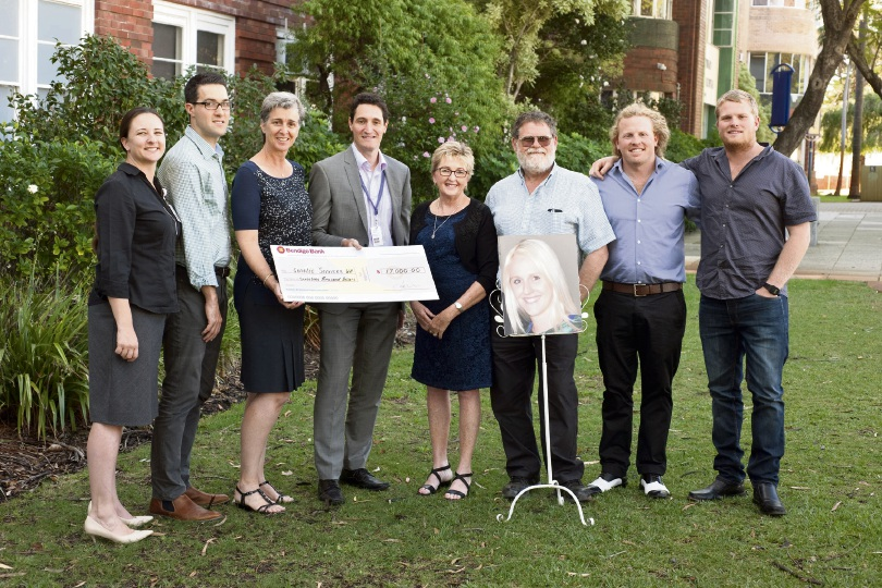 Genetic Services of WA clinic members Anne Hawkins, Nik Stoyanov, Helen Mountain and Nick Pachter with Sofoulis family members Wendy, Darryl, Zack and Matt with a photo of Alecia.