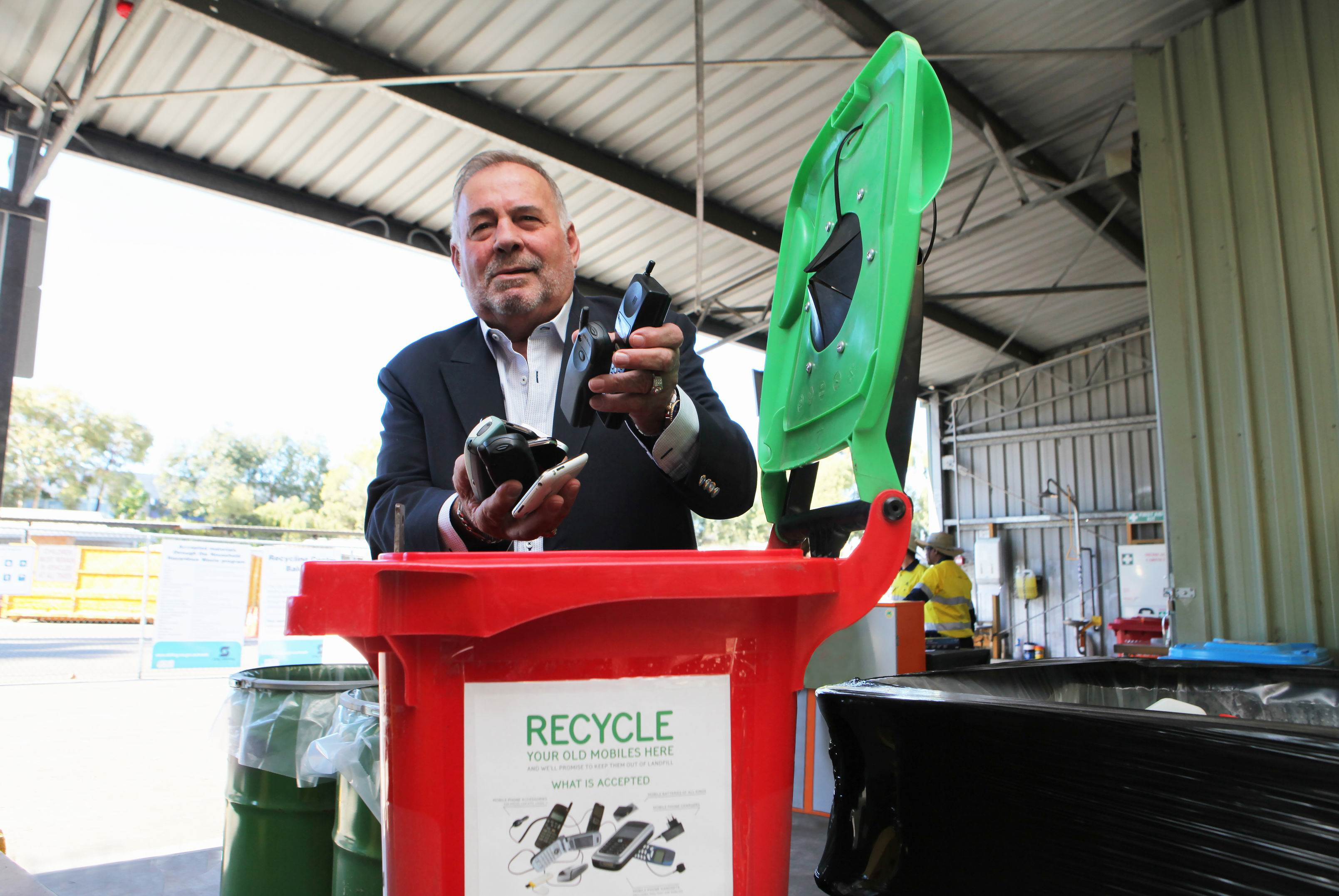 Stirling Mayor Giovanni Italiano with a mobile phone recycling bin. Picture: Michael Gill