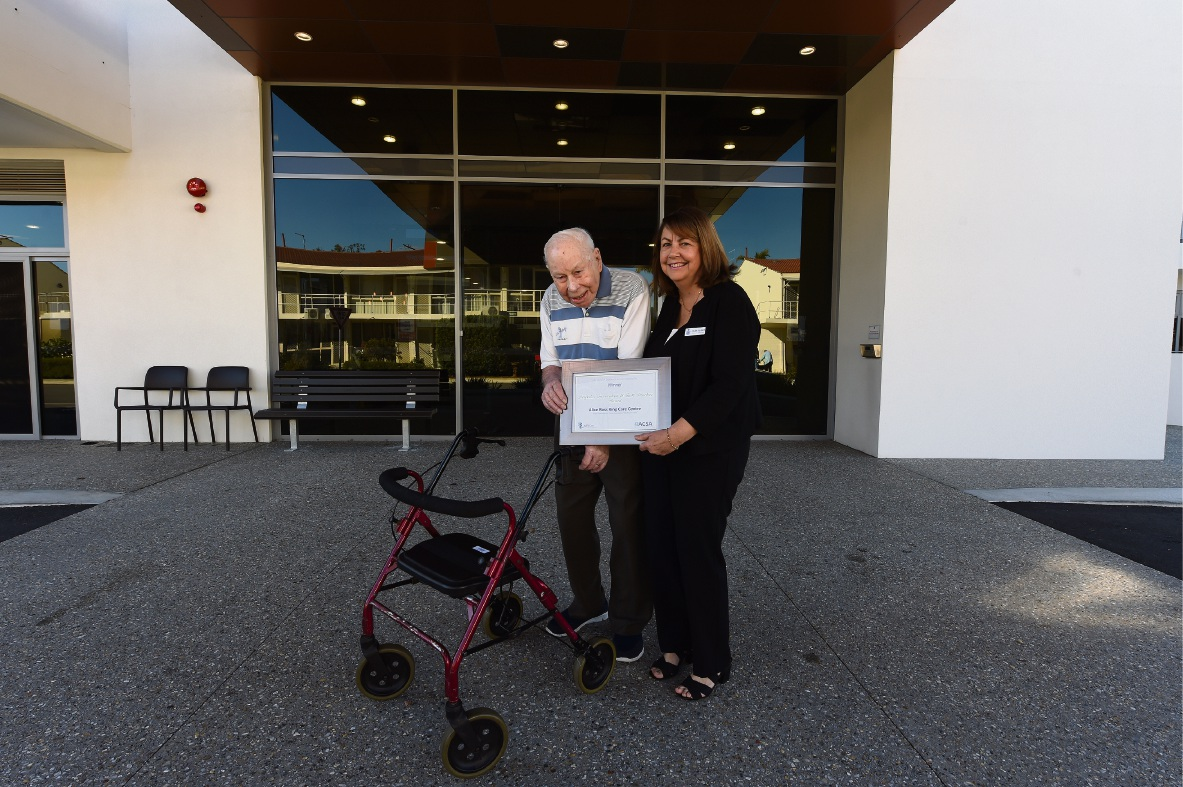 100-year-old RAAFA Bull Creek resident Ted O'Callaghan with facility manager Helen Falkiner. Picture: Jon Hewson