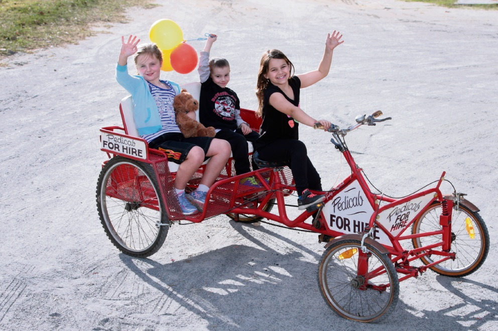 Bianca Lack and Saxon and Sierra Quilty ride the pedicycle built by Fremantle prison inmates. Picture: Bruce Hunt Pictures: Bruce Hunt �������www.communitypix.com.au   d470410