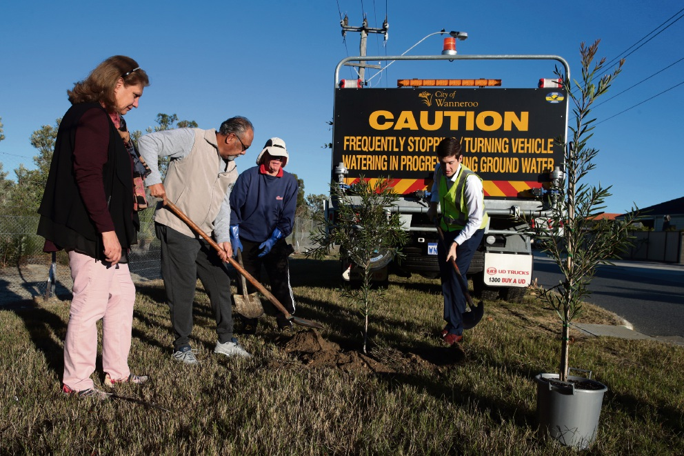 Volunteer tree planters Mahtab and Hector D'Rozario (Landsdale),Terry Hall (Landsdale) and Wanneroo councillor Domenic Zappa. Picture: Martin Kennealey