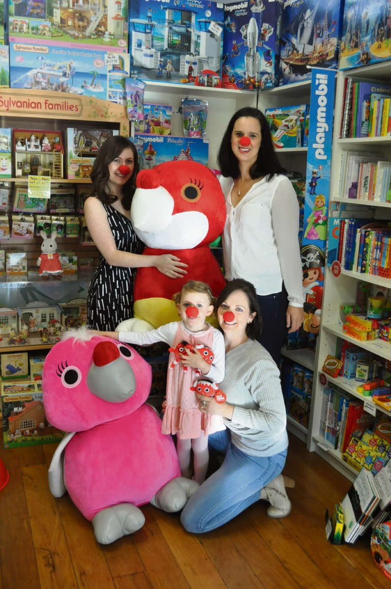 Rikki Stewart and Lara Parsons (back) with Toys in the Park staff member Sarah Hayward and her daughter Alexandra Moran (4).
