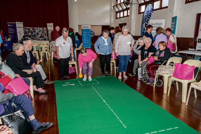 Seniors having a go at carpet bowls at a previous event. Picture: SRCWA