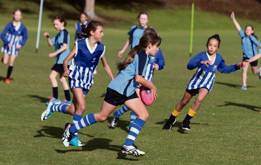 Northern suburbs students get taste of footy at Docker's Cup girls competition