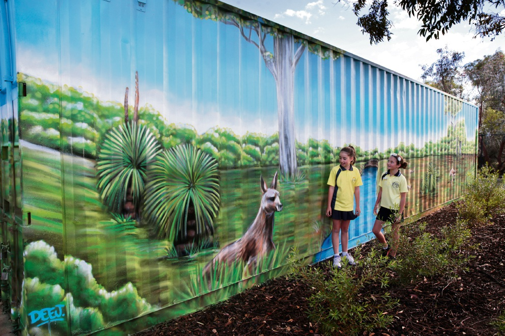 Year 6 girls Hannah Cheetham and Lucy Toms admiring the mural on the sea container. Picture: Martin Kennealey www.communitypix.com.au   d469988