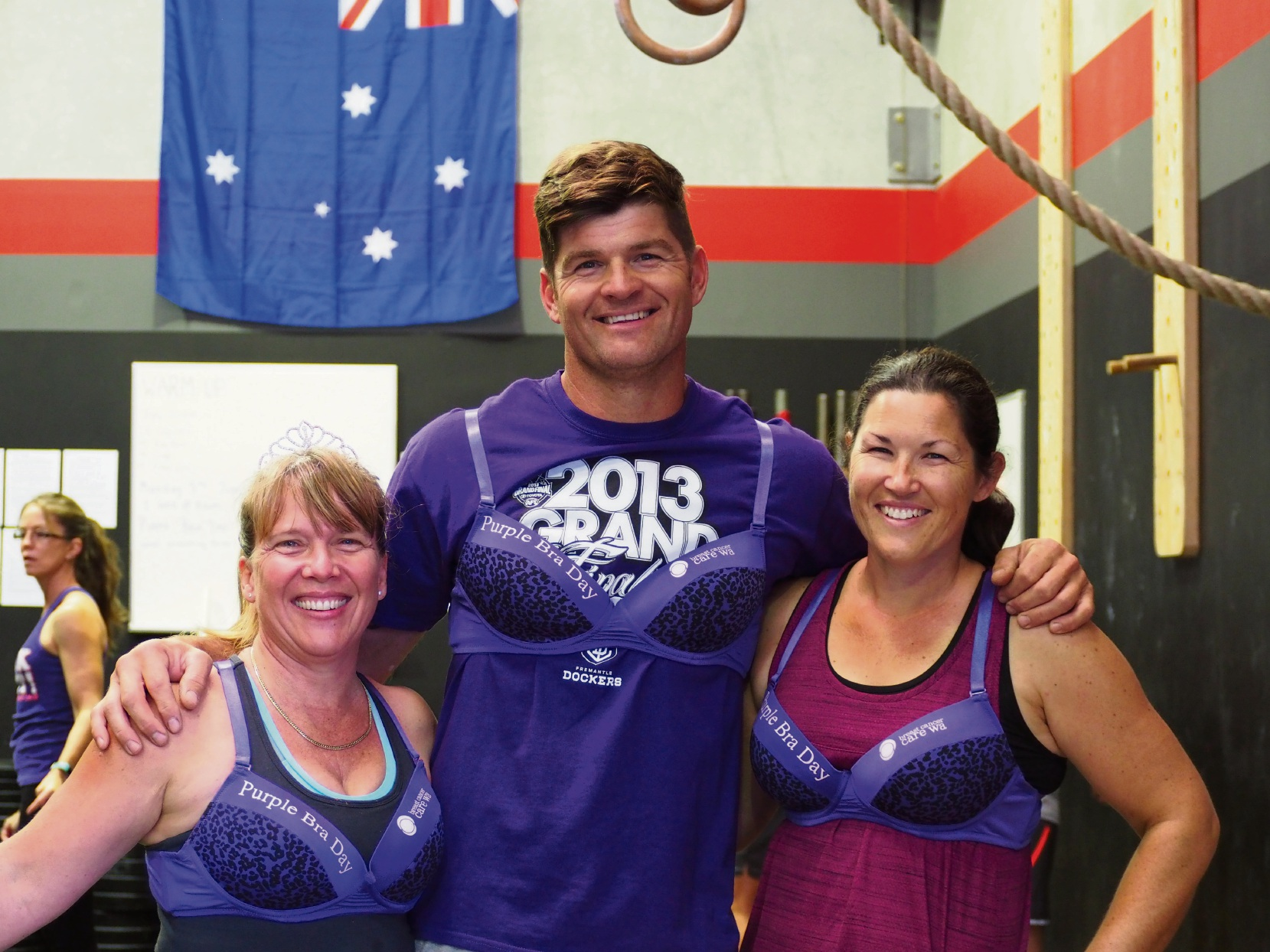 Deborah Alderdice, Josip Matic and Disa Shallue proudly show off their purple bras.