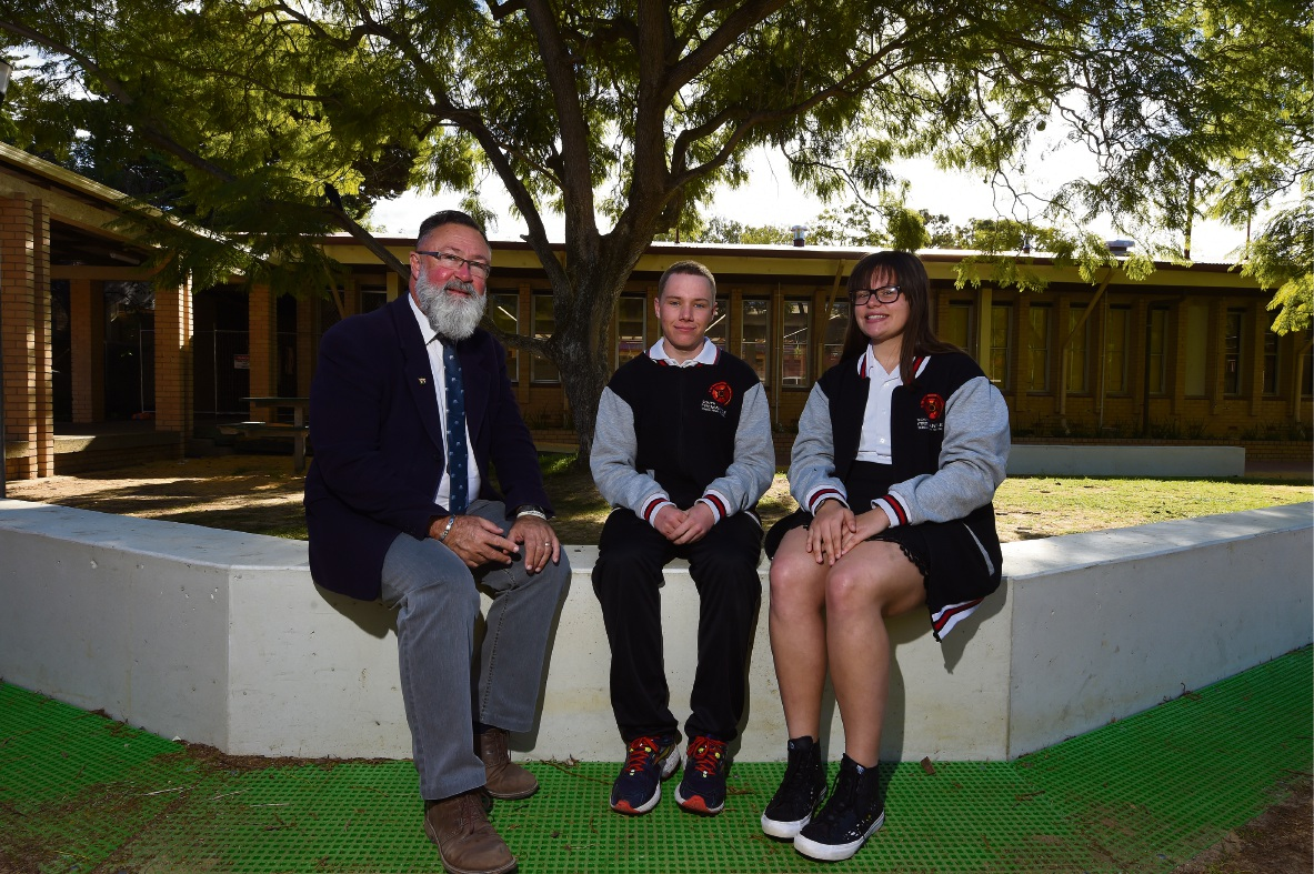 Deputy principal Neil Wilson with head boy Jacob Buckland and head girl Harmony O'Connor.