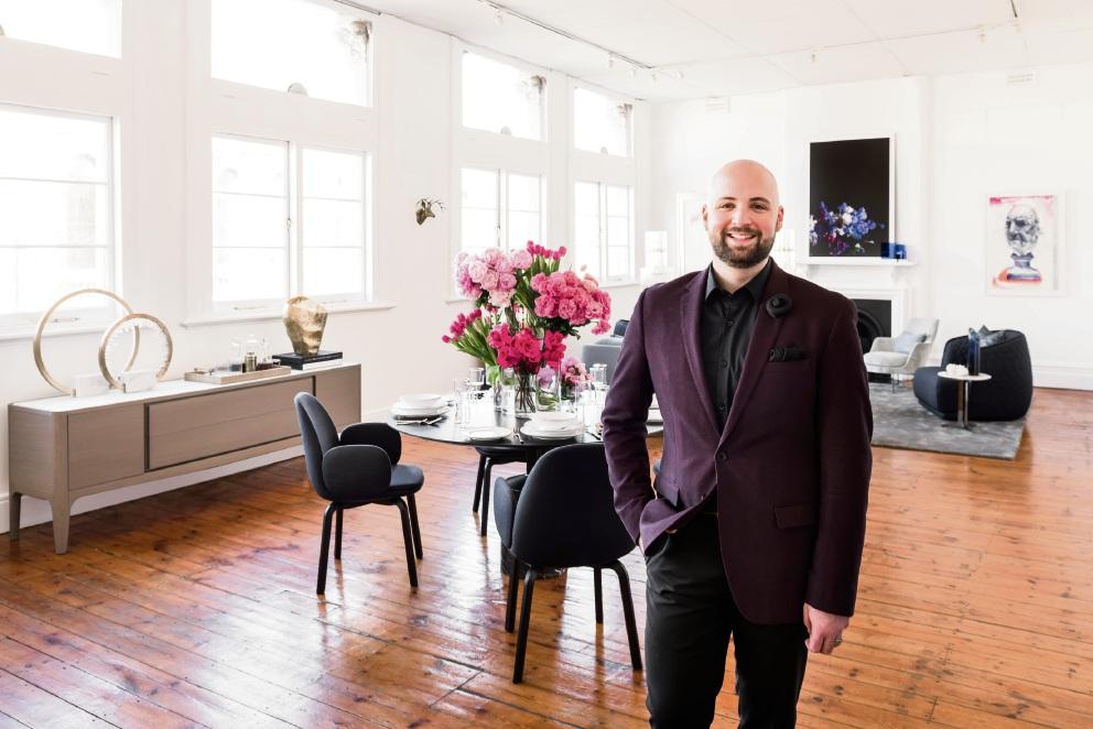 Nickolas Gurtler in the transformed Detail office.