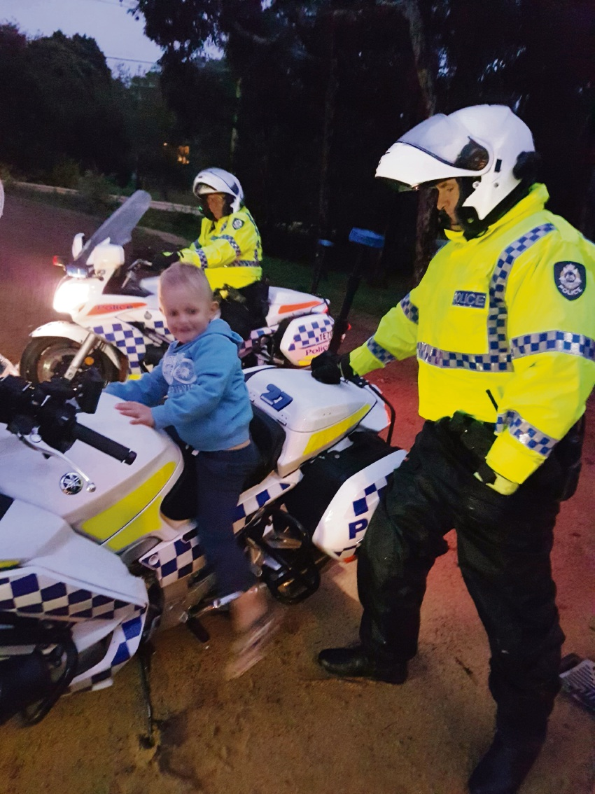 Traffic police with four-year-old Elliot. Picture: Rebecca Morton
