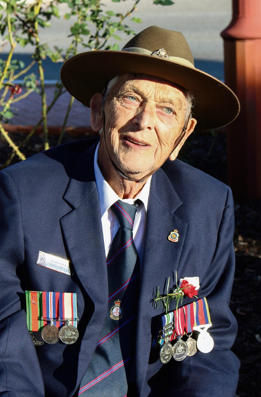 Graham McKay proudly wears Australian service medals and those of his father.