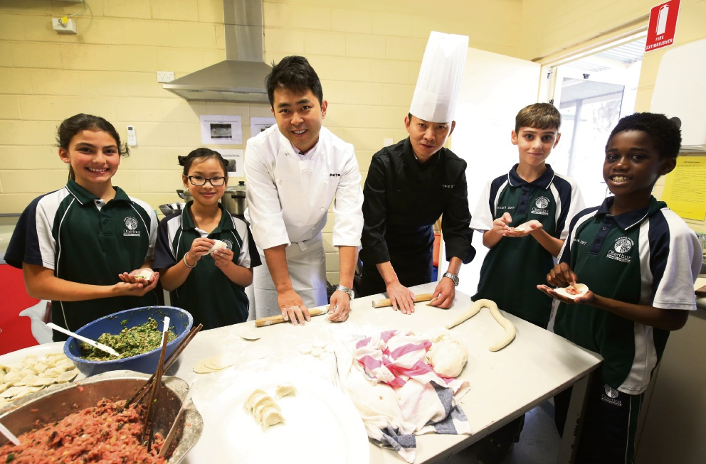 Gracie Willetts (Year 5), Samantha Lauw (Year 4), Matthew Johnston (Year 6) and Ariko Mujati (Year 6) with Chefs Xiong Jiangli and Chen Rongjian. Picture: Matt Jelonek d470878