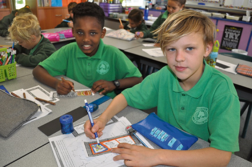 Hawk Boisuert (Year 4) and Benjamin Krumholz (Year 5) creating bookmarks.