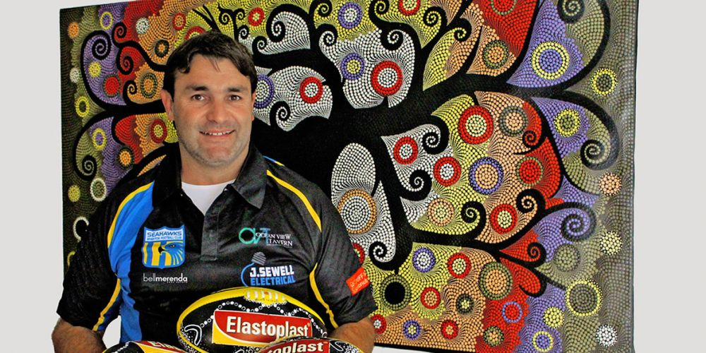 Richard Websdale with his specially designed football for Brighton's Naidoc Game this weekend.