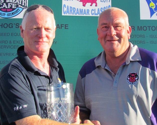 Gary McDonald receives the prize from sponsor Phil Bailey of Hog's Breath Cafe.
