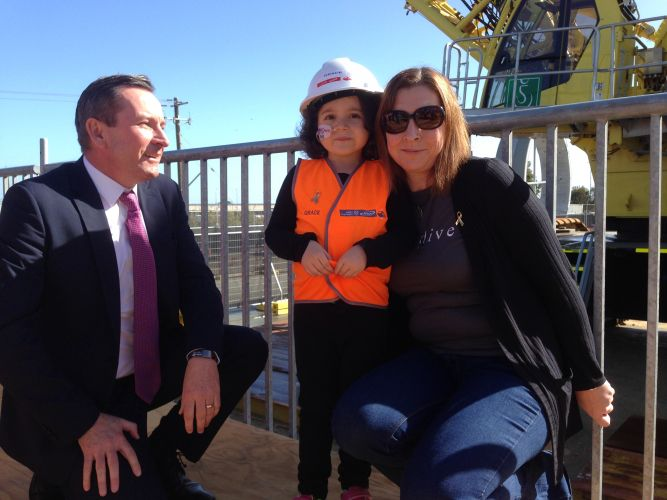 Premier Mark McGowan with Grace and her mother Catherine McPhee. Picture: J Bianchini