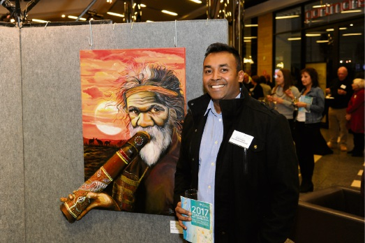 Saravanan Balasubramaniam with his artwork Dawn.