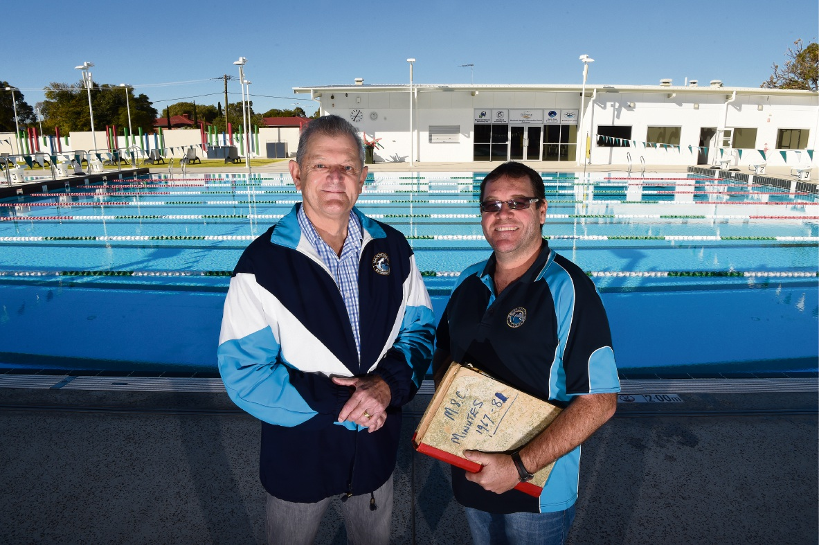 Greg Jenkinson and club president Graham Shackles with the original minutes book. Picture: Jon Hewson d471091