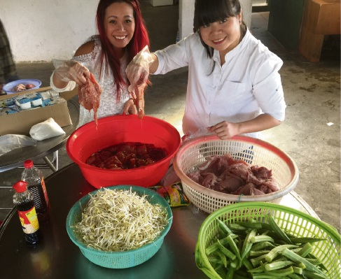 Jenny Do and friend Cuc Mai cooking lunch at the Lam Dong Blind Association.