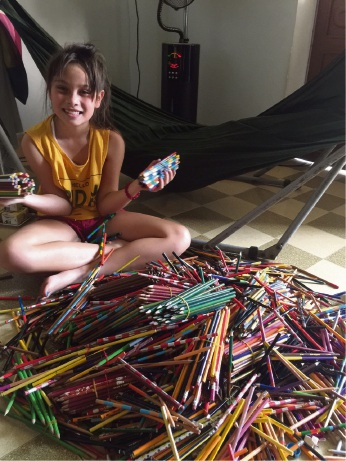 Jenny Do's daughter Chi Chi packing the school supplies to donate.