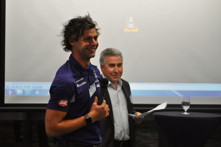 Dockers midfielder Brady Grey with Melville Cockburn Chamber of Commerce president Tony Romano.