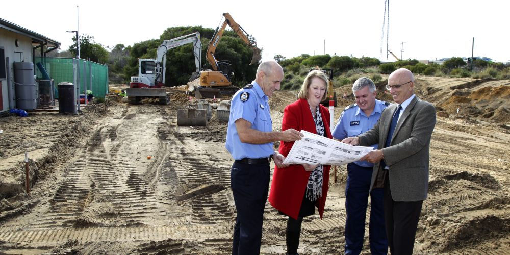 Superintendent Paul Dallimore, Police Minister Michelle Roberts, Sergeant Chris Wride and Butler MLA John Quigley looking at the plans for the station's expansion at the site. Picture: Marie Nirme d471331